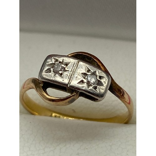 5 - A ladies 18ct gold and Platinum Diamond ring. Designed with two diamonds. [Ring size K] [2 Grams]...