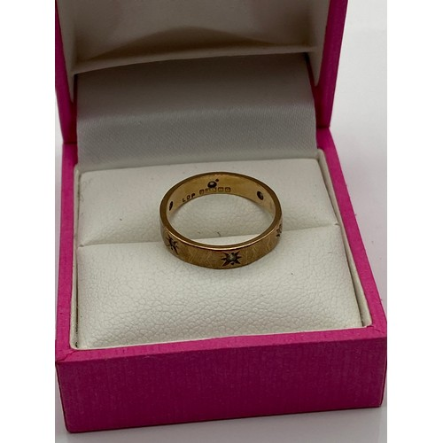 6 - A 9ct gold band ring set with 6 fitted clear stones. [Ring size L] [2 Grams]...