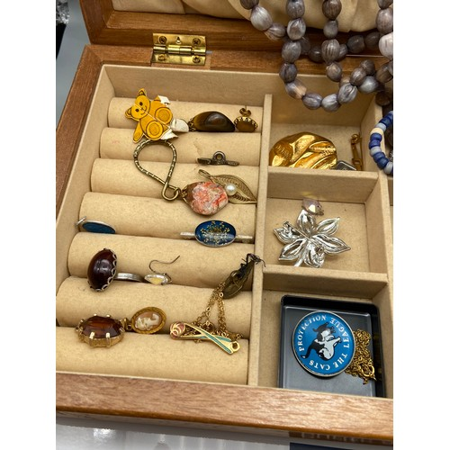 10 - A Jewel box containing a quantity of mixed jewellery and crucifix....