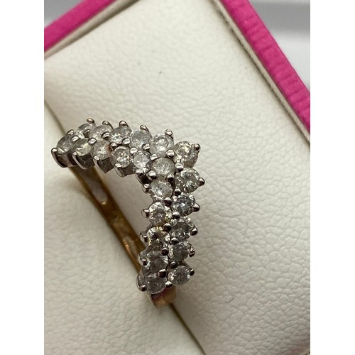12 - A Ladies 9ct gold and diamond ring in a wish bone design. [0.88cts][Ring size I] [2 Grams]...
