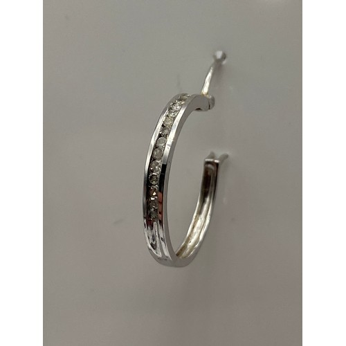 15 - A Pair of 9ct white gold and diamond hoop earrings. [0.16cts in total] [2 grams]