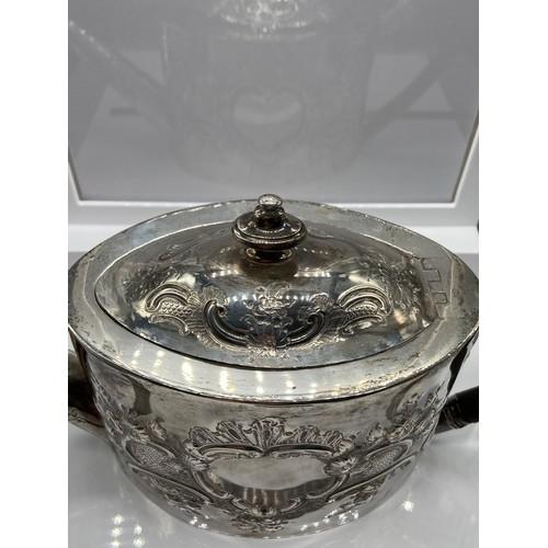 27 - A Georgian London Silver ornate tea pot. Designed with a horn handle. Maker - George Burrows (I) Dat...