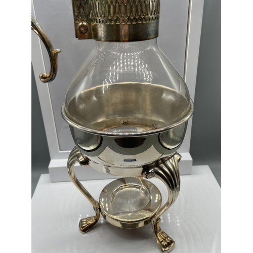 26 - A Vintage F.B Rodgers Silver Company silver plated stand and claret jug....