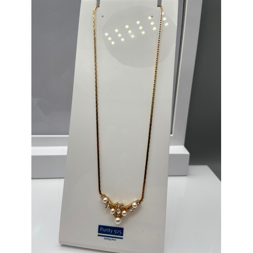 23 - Christian Dior gold plated ladies necklace and ornate pendant designed with pearls and clear stones.