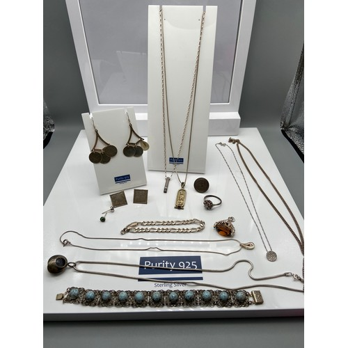 22 - A Quantity of various silver jewellery which includes silver and brown stone swivel fob, Egyptian in...