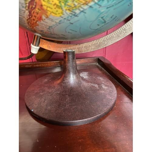 3A - A vintage light up desk globe designed on a bakelite stand. [37cm in height]...