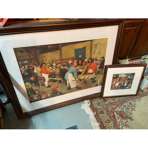 24A - Two framed antique style prints of people celebrating and dining....