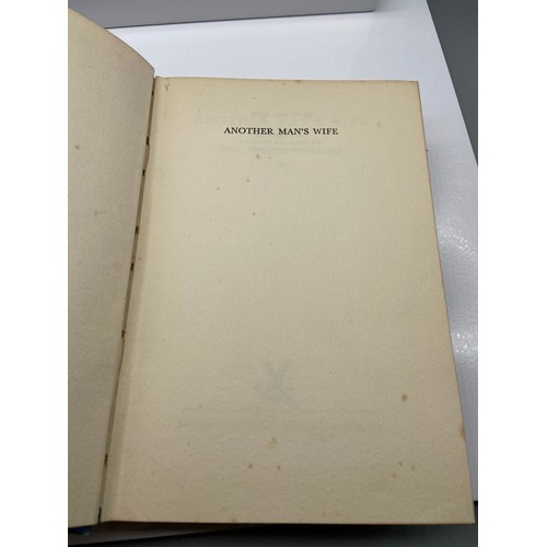 12 - A 1st edition book titled 'Another Man's Wife' by Mrs Belloc Lowndes. Inscribed by Belloc Lowndes. D...