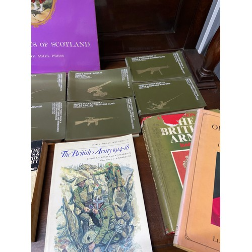28 - A Box containing a collection of military books which includes Jane's Pocket Books, Germany Speaks b...