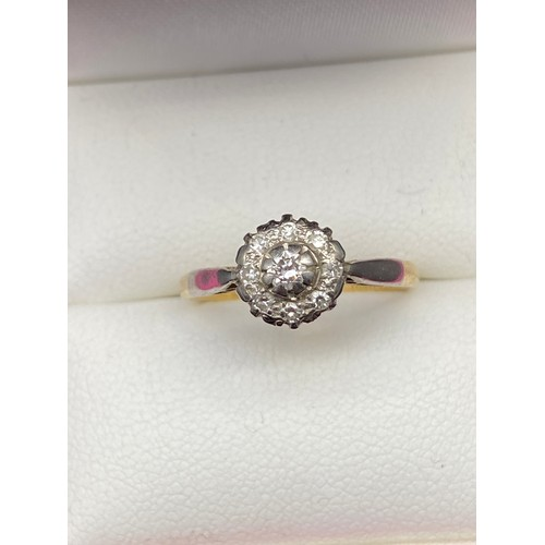 5J - A Lovely example of a ladies 18ct gold diamond ring. Set with a single diamond centre of set by 8 ot...