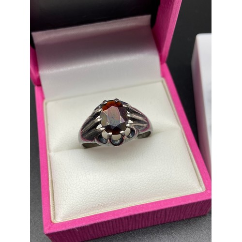 10J - A nice example of a gent's silver and garnet ring [Size U] Together with four various silver brooche...
