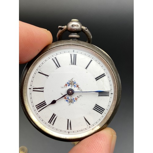11J - A Birmingham silver cased pocket watch designed with an enamel face. Comes with two keys. [Spring ma...