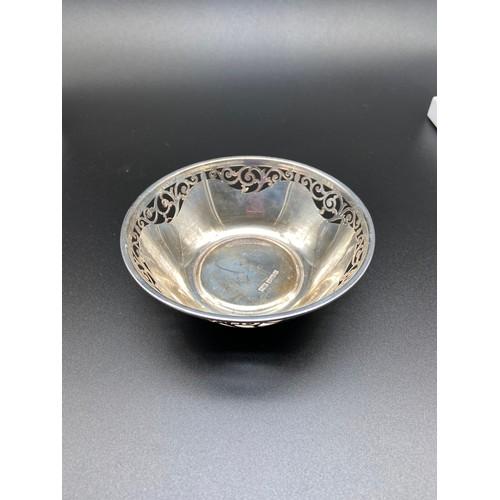 12J - A Sheffield silver pierced trinket bowl. Produced by Robert & Belk and dated 1906. [10.8cm in diamet...