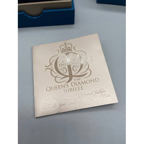 16J - 2012 Queens Diamond Jubilee gold plated silver proof five pound coin by The Royal Mint. Comes with a...