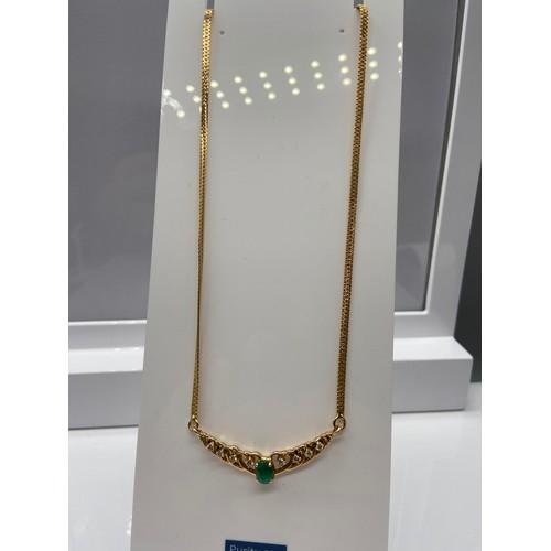 30J - A Ladies 22ct gold Single Emerald and diamond pendant/ necklace. 0.24ct of diamonds. [11 grams] [cha...