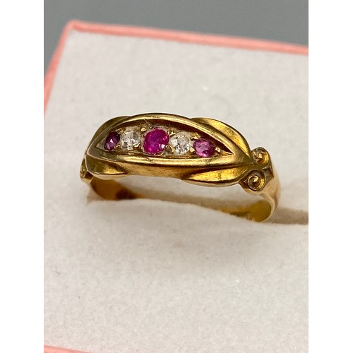 32J - A Ladies 18ct gold diamond and pink stone ring. [Ring size J]...
