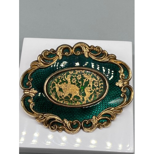 41J - An Exquisite 19th century Anglo Indian gold and green enamelled brooch/ pendant. Centre panel depict...