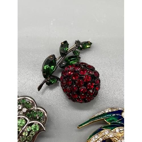 114 - A Vintage Attwood & Sawyer peacock brooch, A Vintage 1950's Schreiner Ney York Rhinestone berry broo...