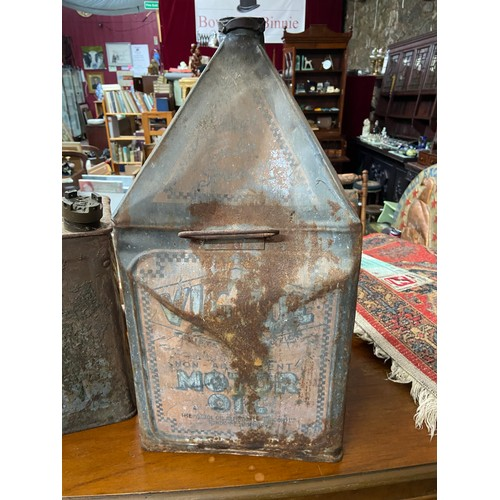 613 - Two vintage petrol and oil cans. To include BP Petrol can and Vigzol motor oil can...
