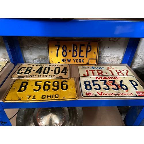 603 - Five vintage American car registration plates....