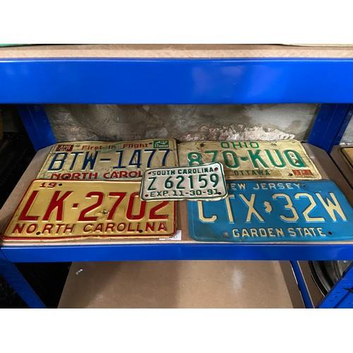 601 - Five vintage American car registration plates....