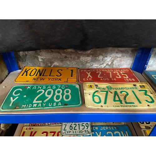 600 - Four vintage American car registration plates....