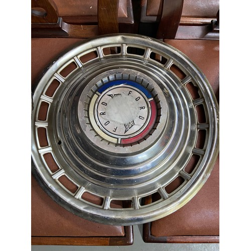 599 - Four various vintage classic car rims to include Buick, Pontiac, Chevy and Ford...