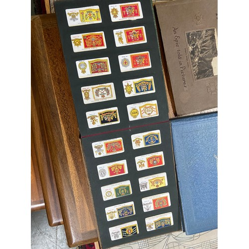 547 - Four Albums of various vintage cigarette cards...