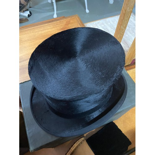 544 - Antique Moss Bros Silk top hat with carry case, pad and brush.