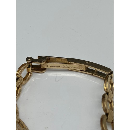 2J - A Vintage ladies Avia 9ct gold wrist watch. Designed with a 9ct gold bracelet. In a working conditio...