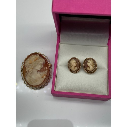 12J - A 9ct gold cameo brooch/ Pendant together with a pair of yellow metal cameo earrings [Unmarked]....
