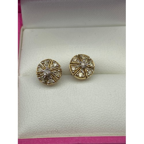 13J - A Pair of 9ct gold and diamond earrings. [1.50grams]...