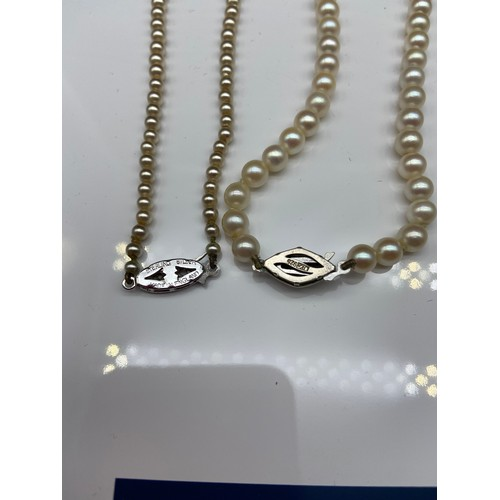 14J - Two vintage pearl necklaces, fitted with silver claps....