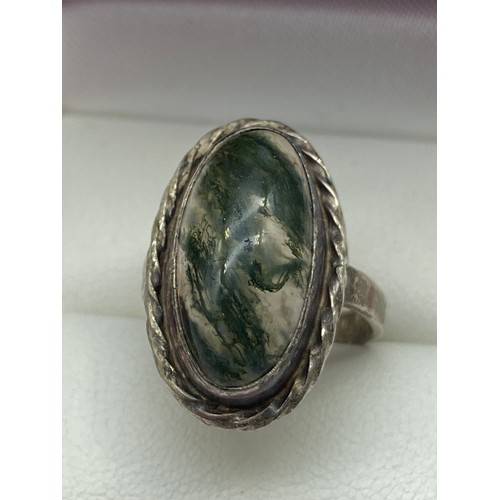 16J - An Edinburgh silver and agate ring, together with a white metal, agate and citrine Scottish Brooch....