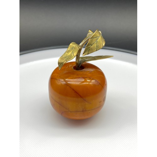 18J - An Antique Butterscotch Amber and bronze/ brass apple sculpture. Signed to the underside of the leaf...
