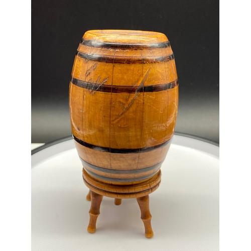 20J - An Antique barrel design cigarette dispenser...