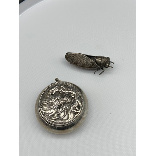 21J - A White metal Chinese dragon design snuff pendant, together with a white metal locus bug brooch....