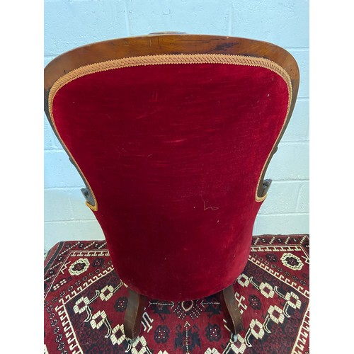 2C - A Victorian Red button back library/ Fire side arm chair. Standing 112cm high....