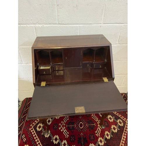 4C - An 18th/ 19th century writing bureau. Designed with a shell carved front secret drawer. Supported up...