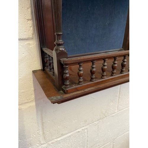 8A - A 19th century dark wood wall shelving unit. designed with a carved lady portrait/ silhouette to the...