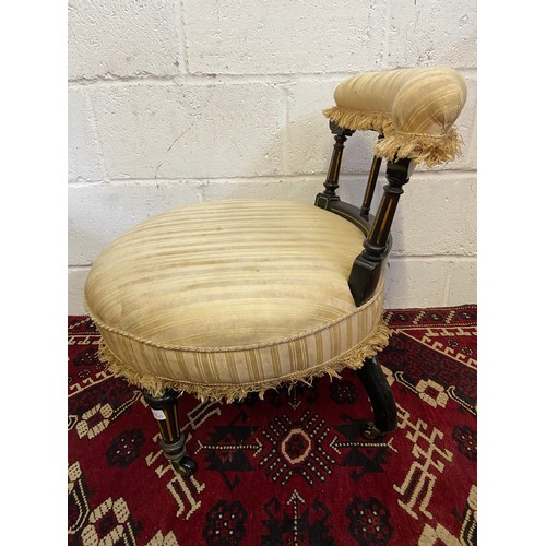 10 C - A 19th century nursing chair, Designed with turned leg supports with gilt trims and ceramic castors....