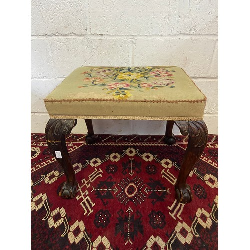 13B - A 19th century carved ball and claw leg, dressing table stool. Finished with a floral bouquet tapest...