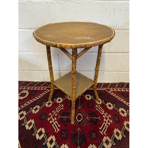 14C - A 19th century bamboo and weaved two tier side table. [Standing 70cm high and 52cm wide]...
