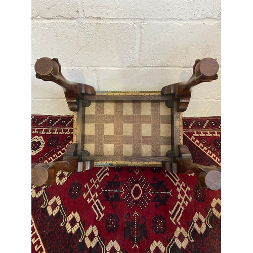 17B - A 19th century dressing table stool, designed with a floral tapestry top and carved claw and ball fe...