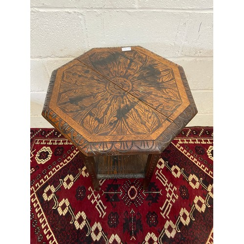 22B - A 19th century Jacobean style hand carved two tier side table.[ Standing 73cm high and 53cm in width...