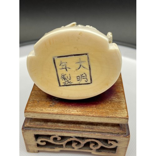 26A - A Chinese Ming Dynasty ivory carving of an emperor sat on a throne. Beautifully carved showing drago...
