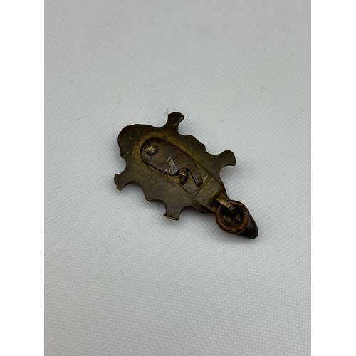 27A - An Antique Chinese bronze made turtle pendant with hidden snuff compartment. [4.7cm in length]...
