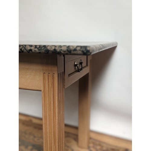 1 - A contemporary table with single under drawer to each end and finished with a heavy granite top...