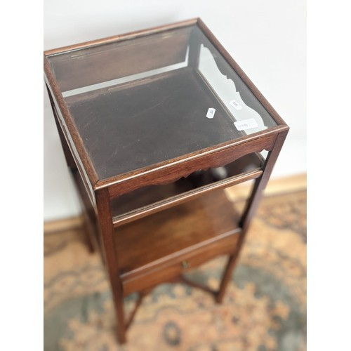 3 - A dainty and narrow Georgian display piece with centre support to the base, single drawer to the mid...
