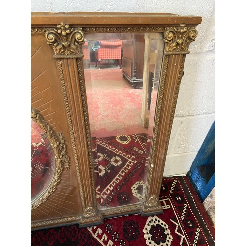 14 - A Large 18th/ Early 19th century gilt painted and moulded wreath over mantle mirror. Triple Beveled ...